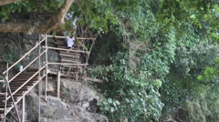 Ao Nang, Krabi Province, Thailand. Man climbs the wooden stairs Stock Footage