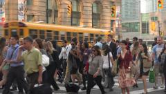 Crowd of Toronto city business people walk across Front Street Stock Footage