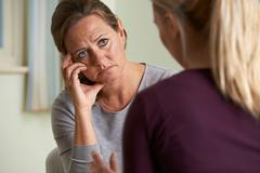 Mature Woman Discussing Problems With Counselor Stock Photos