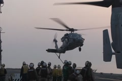 MH-60S Seahawk Lands on the Flight Deck of US Navy Vessel Stock Footage