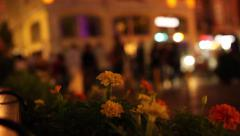 Soft focus view of night life taking from a restaurant's outdoor seat  - stock footage