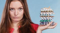 Woman holding pills tablets. Drug addict. Stock Photos
