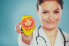 Dietitian with vegetables. Healthy diet nutrition. Stock Photos