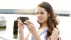 portrait of young asian women sitting on couch at home using smart phone - stock footage