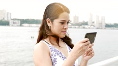 Beautiful asian women using smart phone searching the web. lifestyle background Stock Footage