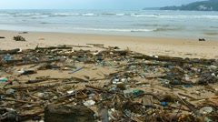 Tropical Beach Covered in Litter and Debris. 4k video - stock footage