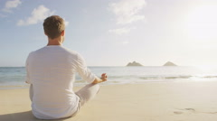 Man Meditating On Shore At Beach Doing Yoga In Serene Nature Stock Footage