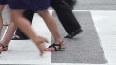 Close up of legs and feet of people crossing street Stock Footage