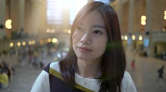 lifestyle portrait of young cute asian women looking at camera. city people view - stock footage