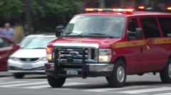 Toronto emergency fire service vehicle with flashing lights - stock footage