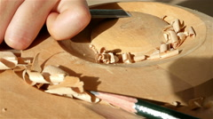 Stock Video Footage of Wood carving - Human hand chiseling a piece of wood