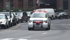 Toronto paramedic emergency service vehicle with flashing lights and siren Stock Footage