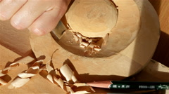 Wood carving - Human hand chiseling a piece of wood - stock footage