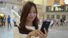 Happy young women using smart phone. city people background Stock Footage