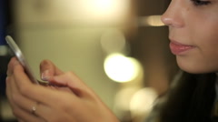 Point of view of a young woman using a smart phone for texting and browsing Stock Footage