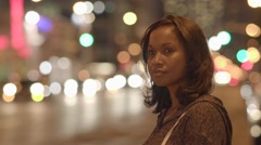Young black women standing on street in the city at night using tablet pc Stock Footage