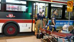 4K UHD - Fire and ambulance crews giving first aid in transit bus - stock footage