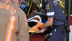 4K UHD - Emergency crews lifting patient out of bus onto stretcher Stock Footage