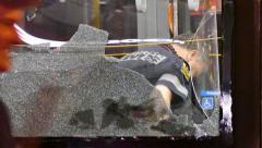 4K UHD - Paramedic viewed through shattered bus window - stock footage