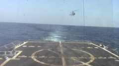 Chinese Military Helicopter Lands on Deck of US Naval Destroyer Stock Footage