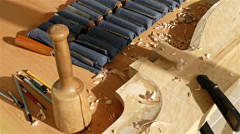Stock Video Footage of Wood carving - Human hand packing away a chisel in a set with instruments