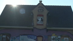 Sun Shining over Roof One-Eyed Giant Graffiti House - Editorial - 29,97FPS NTSC Stock Footage