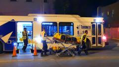 4K UHD - Large bus-converted ambulance with paramedics Stock Footage