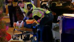 4K UHD - Paramedic crews strapping patients onto stretchers - stock footage
