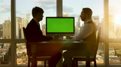 Two young entrepreneurs talking about business. charts diagrams. green screen Stock Footage