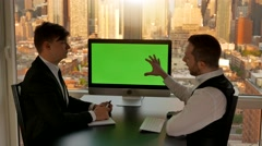 Two business professionals having a meeting in modern office talking together Stock Footage
