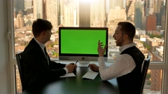 two business professionals having a meeting in modern office talking together - stock footage