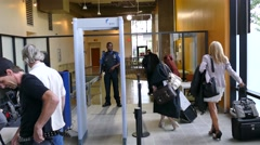 4K UHD - Lady lawyers going through security gate at courthouse Stock Footage
