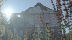 Sunlight over Broken Deserted Building - Editorial -  25FPS PAL - stock footage