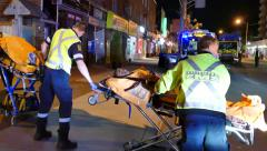 4K UHD - 3 paramedics carrying 2 stretchers with patients - stock footage
