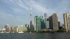 Tracking shot of Queens Quay, Waterfront docks and CN Tower, Toronto, Canada Stock Footage