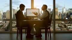 Business people in high rise office building. city skyline window view Stock Footage