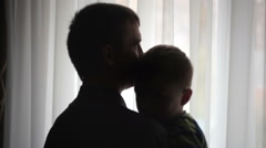 Happy father holding his son on hands in room Stock Footage