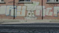 Zebra Crossing to Wall with Graffiti Nuclear Plant - Editorial - 29,97FPS NTSC Stock Footage