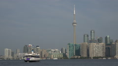 Toronto ferry leaves centre island for Toronto, skyline in background Stock Footage