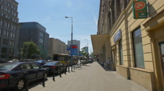 Traffic on Aleje Jerozolimskie street on a sunny day in Warsaw Stock Footage