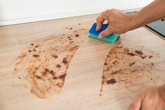 Cropped image of man cleaning kitchen counter with sponge Stock Photos
