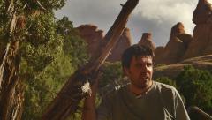 Man lost outside desert wilderness Stock Footage