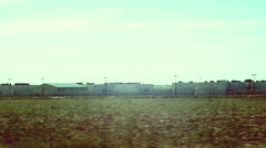 Prison in feild outside prison complex Stock Footage