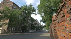 Old buildings and an old red brick wall on Karola Marcinkowskiego street, Warsaw Stock Footage