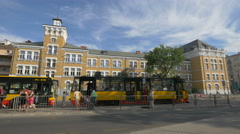 Trams on Solidarity alley, in front of School No. 58 in Warsaw Stock Footage