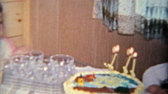 1963: Grumpy jealous stonefaced sister at brothers 3 year old birthday party. Stock Footage
