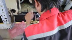Engineer to repair part of engine Stock Footage