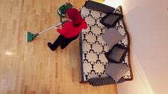 Housekeeper cleaning floor using vacuum cleaner Stock Footage