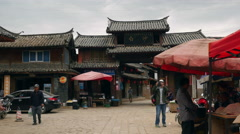 Tourists Shopping At A Local Baisha Village. Stock Footage