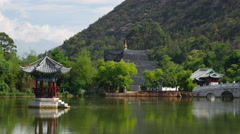Pavilion At The Black Dragon Pool Jade Dragon Snow Mountain LijiangChina Stock Footage